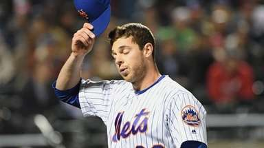 Mets starting pitcher Steven Matz walks to the