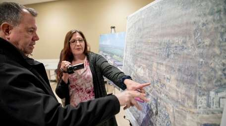 Residents look at a map of the Elwood