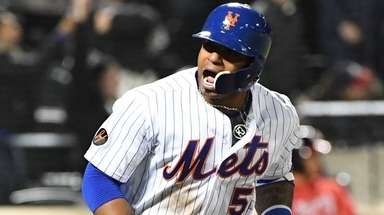 Yoenis Cespedes reacts after he hits a grand