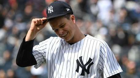 Yankees starting pitcher Sonny Gray walks to the