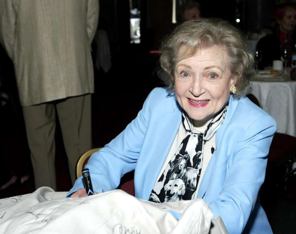 Actress Betty White signs aprons to be auctioned