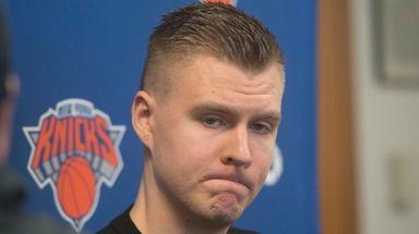 Knicks forward Kristaps Porzingis speaks with the media