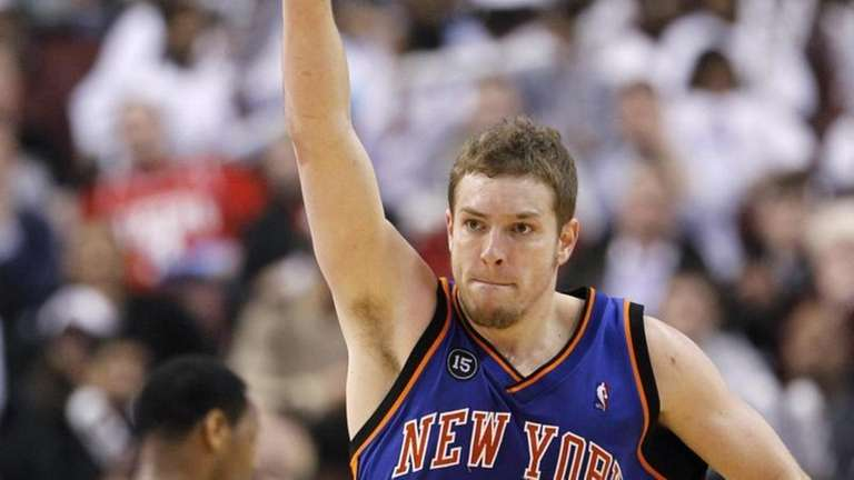 New York Knicks' David Lee celebrates after scoring