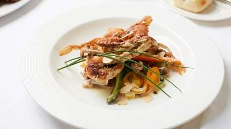 Soft-shell crabs with spring vegetable fricassee are a