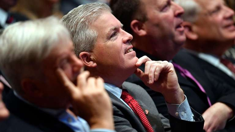 Suffolk County Executive Steve Bellone listens to the