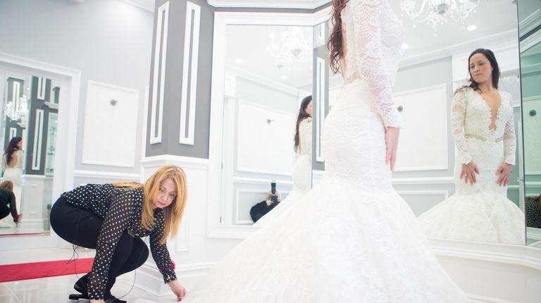 Seamstress Zizi Nasr alters Michelle Fox's dress at