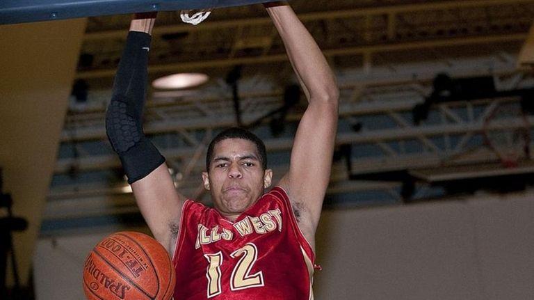 Hills West Tobias Harris slams down a dunk