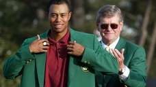Tiger Woods, left, adjusts the 2002 Masters Green