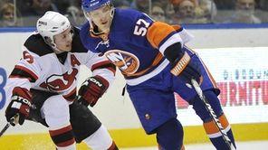 New York Islanders' Blake Comeau (57) keeps the