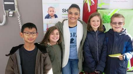 Olympic gymnast Laurie Hernandez with Kidsday reporters Damien