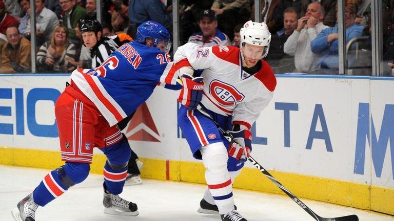 New York Rangers center Erik Christensen (26) challenges