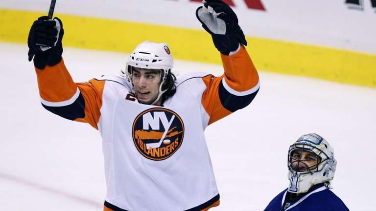 The Islanders' Matt Moulson, left, celebrates a goal