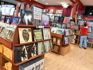 Aisle endcaps display a variety of vinyl records