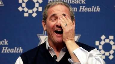 Giants general manager Dave Gettleman reacts to a