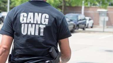 A member of the gang unit leaves Nassau