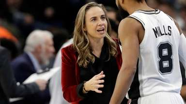 Spurs assistant coach Becky Hammon talks with Patty