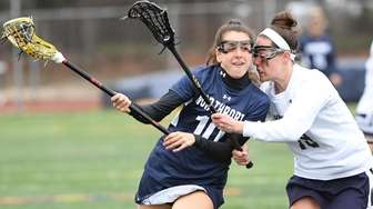Northport midfielder Olivia Carner is defended by Grace