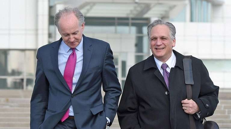 Former Nassau County Executive Edward Mangano, right, leaves