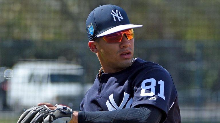Yankees infielder Gleyber Torres works out during spring