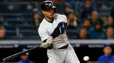 Giancarlo Stanton of theYankees singles in the fifth