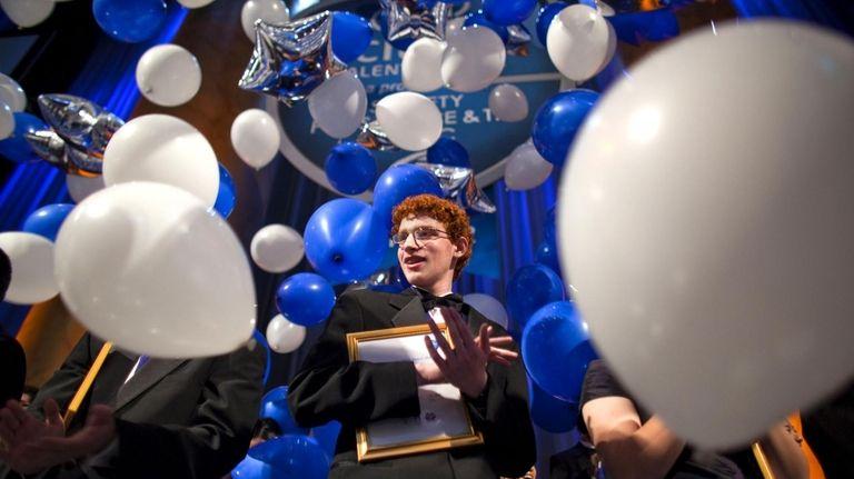 Hewlett High School student Eric Brooks is awarded