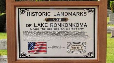 A sign designating Lake Ronkonkoma Cemetery as a