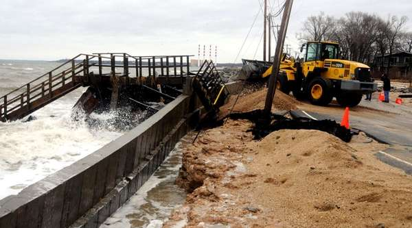 Waves crash over a collapsed seawall in Asharoken