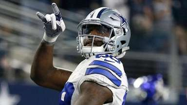 Dallas Cowboys' Dez Bryant celebrates catching a touchdown
