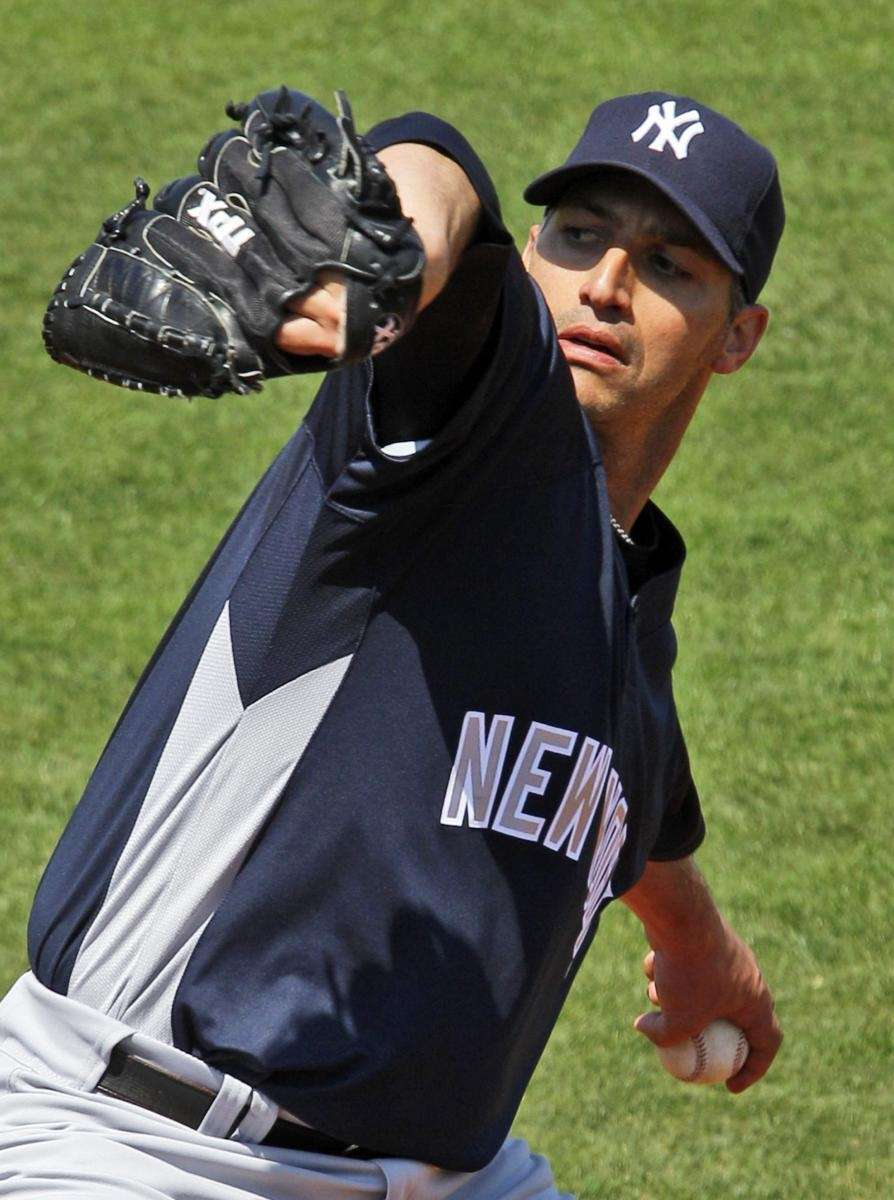 Yankees pitcher Andy Pettitte throws against the Philadelphia
