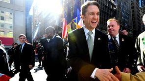 Rick Lazio marches down Fifth Avenue during the