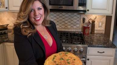 Patricia Balestras with her maccheroni pie, which is