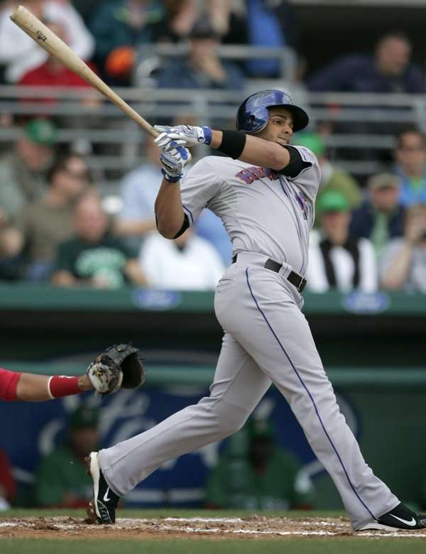 New York Mets' Fernando Martinez swings at a