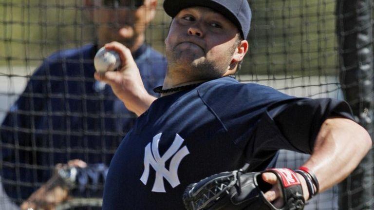 New York Yankees' Joba Chamberlain throws live batting