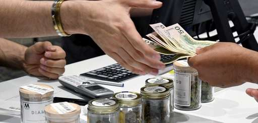 A customer pays for cannabis products at Essence