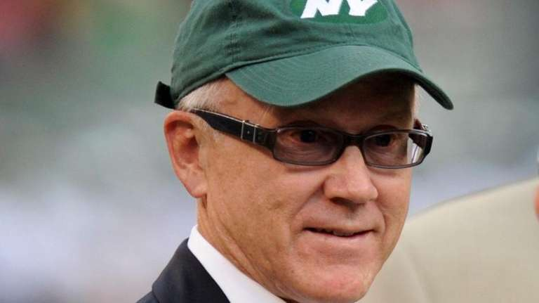 New York Jets owner Woody Johnson watches warmups