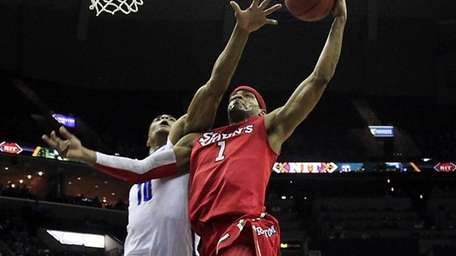 St. John's guard D.J. Kennedy (1) goes to