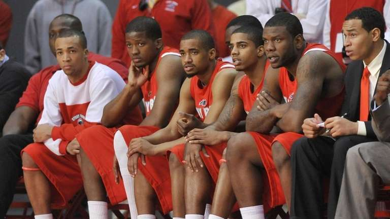 Stony Brook players on the bench watch during