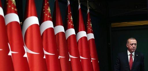 Turkey's President Recep Tayyip Erdogan walks before announcing