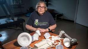 Marian Goldstein displays some of the damaged bulbs