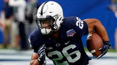Penn State running back Saquon Barkley runs the