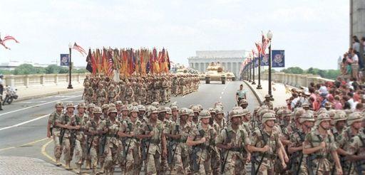 Troops march over the Memorial Bridge in Washington,