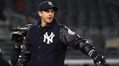 Yankees manager Aaron Boone looks on after a