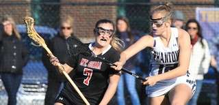 Mt. Sinai's Meaghan Tyrrell is turned away from