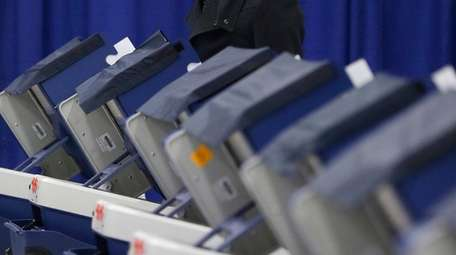 A Chicago resident casts his ballot in Illinois