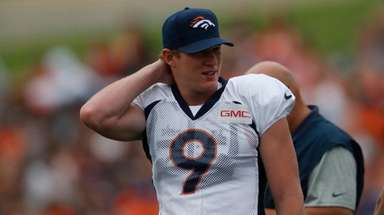 Broncos punter Riley Dixon takes part in drills
