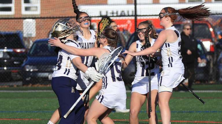 Bayport-Blue Point players celebrate after they defeated Mt.