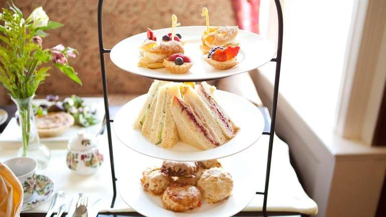A tiered tea service is served at Chat