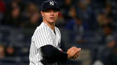 Sonny Gray of the Yankees looks on during