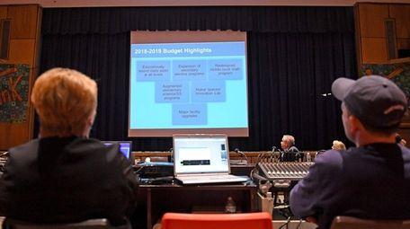 Huntington schools Superintendent James Polansky presents the district's