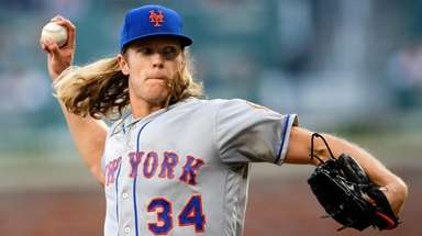 Mets starting pitcher Noah Syndergaard delivers in the